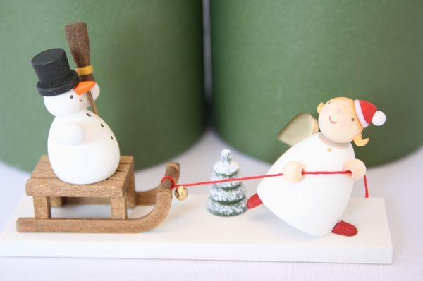 天使と雪だるまのソリ